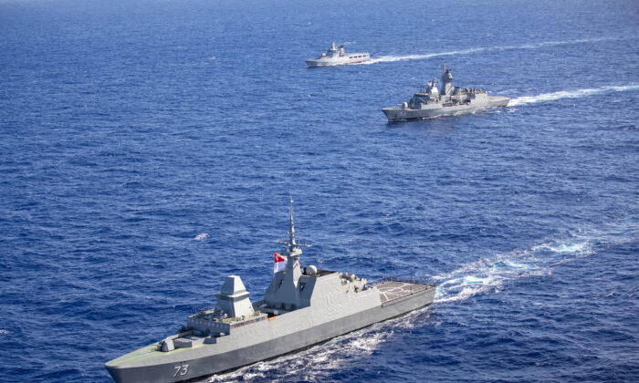 Her Majesty's Australian Ship Stuart sails in company with the Republic of Singapore Ship Supreme and Kapal Diraja Brunei (Royal Brunei Ship) Daruleshan through the Pacific Ocean as they prepare to take part in Exercise Rim of the Pacific 2020 on Aug. 17, 2020. (Australian Department of Defence)