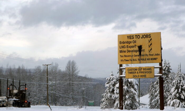 Signage in favour of resource development is seen along Yellowhead Highway near Telkwa in northern British Columbia on Jan. 10, 2019. (The Canadian Press/Chad Hipolito)