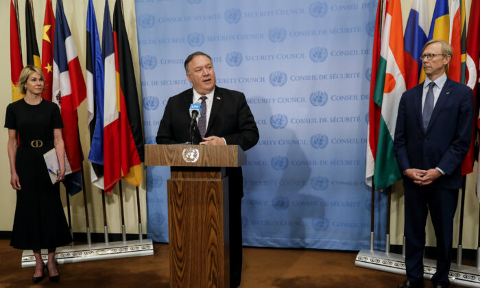 Secretary of State Mike Pompeo speaks to reporters following a meeting with members of the U.N. Security Council on Aug. 20, 2020, as U.S. Ambassador to the United Nations Kelly Craft and U.S. special representative for Iran Brian Hook listen. (Mike Segar/Pool via AP)