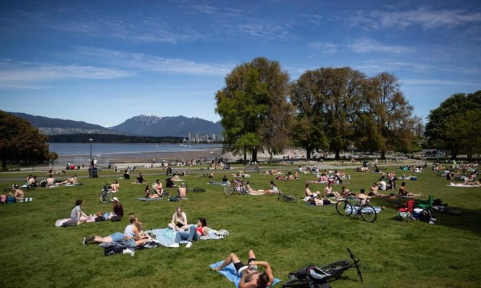 People sit and lie in the sun at Kitsilano Beach Park as temperatures reached highs into 20s according to Environment Canada, in Vancouver, on May 9, 2020. (The Canadian PressDarryl Dyck)
