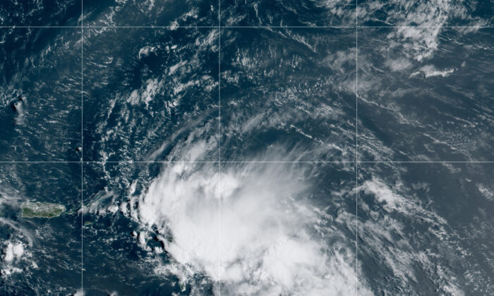 This satellite image released by the National Oceanic and Atmospheric Administration (NOAA) shows Tropical Storm Laura in the North Atlantic Ocean, on Aug. 21, 2020. (NOAA via AP)