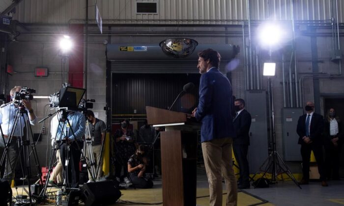 Prime Minister Justin Trudeau takes questions from the media during an announcement on N95 masks at a facility in Brockville, Ont., on, Aug. 21, 2020. (The Canadian Press/Adrian Wyld)