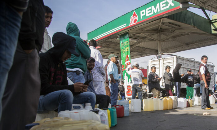 People queue to buy gasoline at a station in Morelia, Michoacan State, on Jan. 7, 2019. (Enrique Castro/AFP via Getty Images)