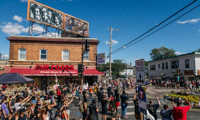 People participate in a demonstration against the city's plans to reopen an autonomous zone known as George Floyd Square, outside Cup Foods in Minneapolis, Minn., on Aug. 17, 2020. (Brandon Bell/Getty Images)
