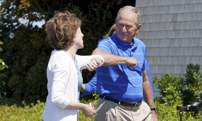 Sen. Susan Collins (R-Maine), left, and former President George W. Bush elbow bump in Kennebunkport, Maine, Aug. 21, 2020. (Mary Schwalm/AP Photo)