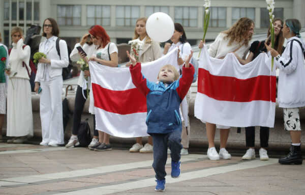 A boy catches a balloon during a protest in Minsk