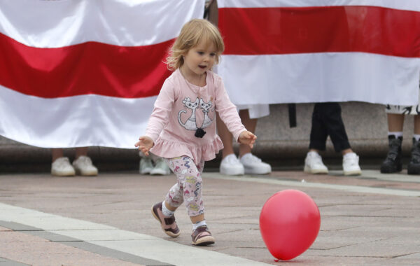 A girl plays with a balloon during a protest in Minsk