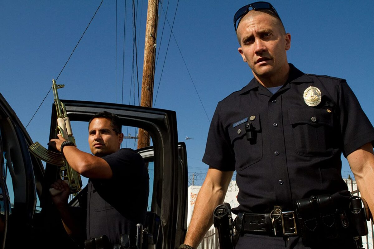 "two cops, one holds AK-47 in ""End of Watch"""