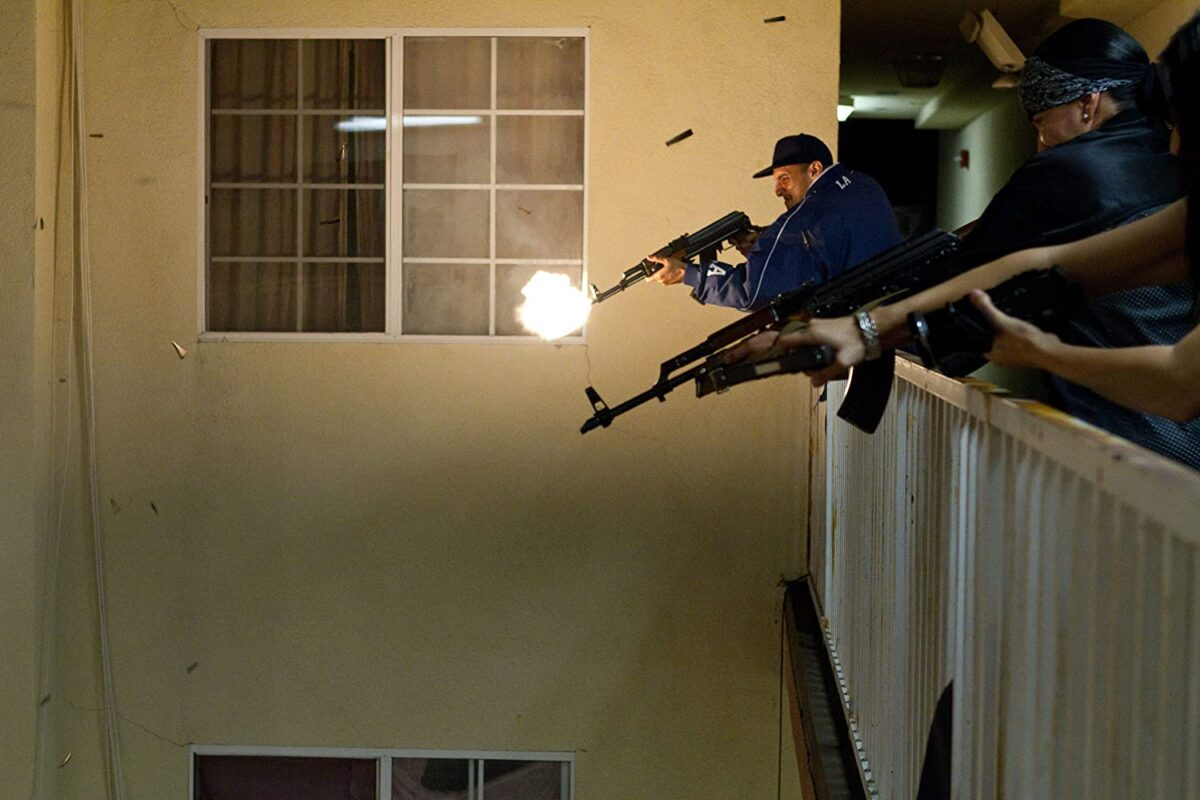 "cartel member firing automatic weapons in ""End of Watch"""