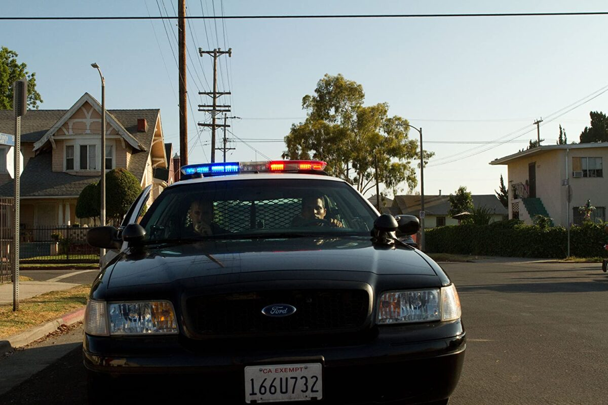 "two police officers in squad car in ""End of Watch"""
