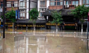 Petitioners in China's Chongqing Claim Detentions, Beatings as Premier Visits Flooded Village