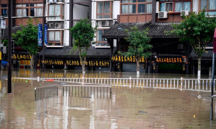 A flooded street in Chongqing, a city located in southwestern China, on Aug. 19, 2020. (STR/AFP via Getty Images)