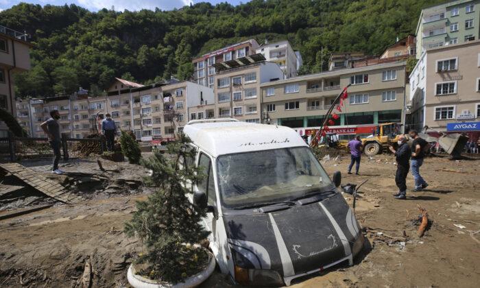 File photo of Turkey floods in the mountain town of Dereli in Giresun province, along Turkey's Black Sea coastline, on Aug. 23, 2020. (AP Photo)