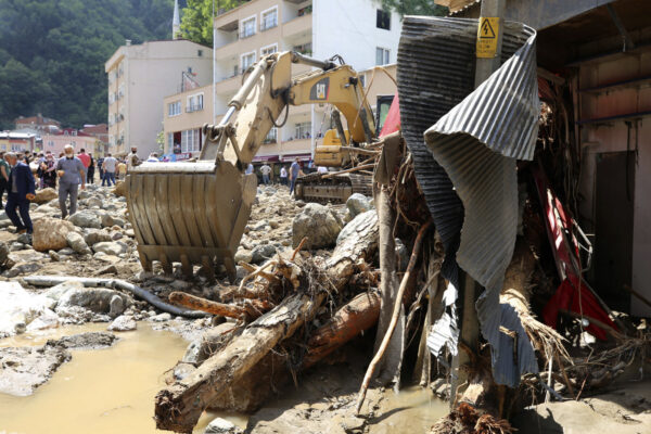 People inspect the destruction after floods