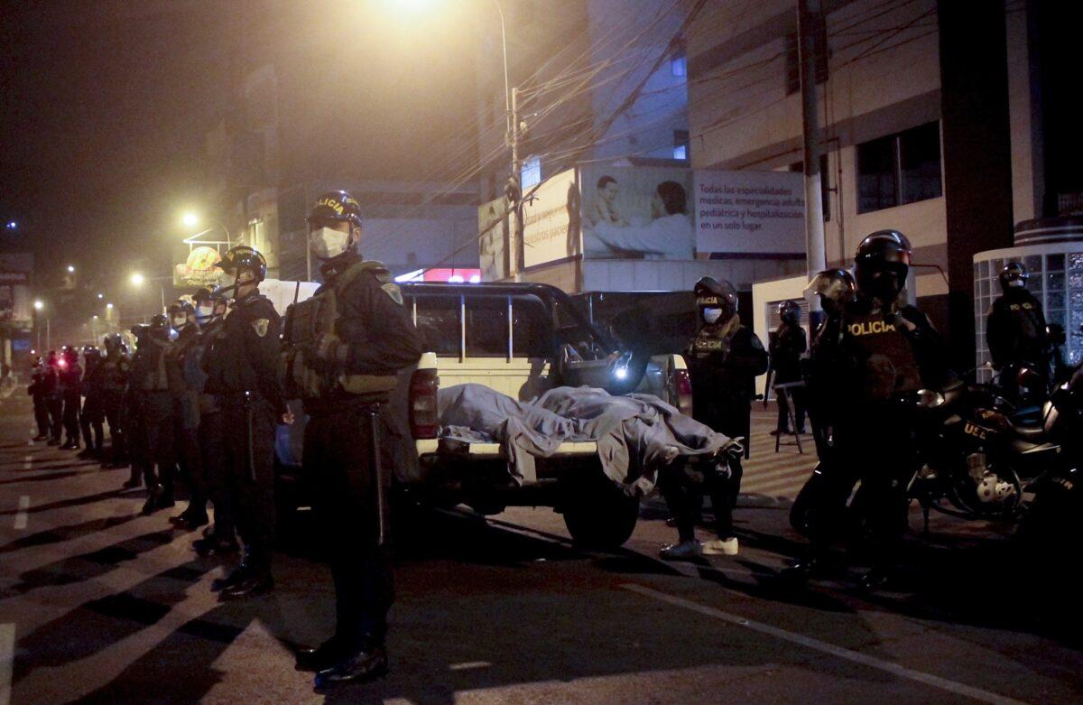 Police at Peru disco.
