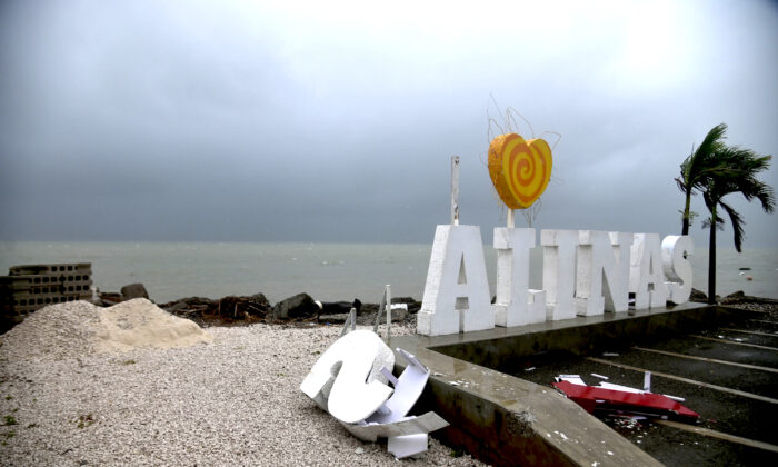 Remnants of city sign lay on the beach, damaged by Tropical Storm Laura in Salinas, Puerto Rico, on Aug. 22, 2020. (Carlos Giusti/AP Photo)
