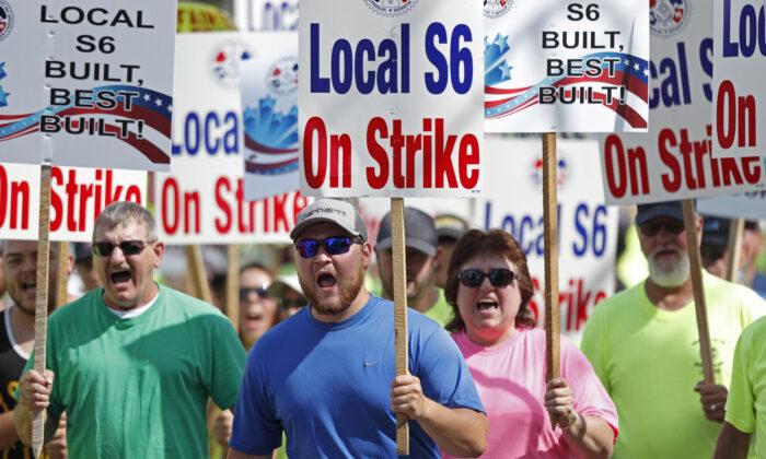 Bath Iron Works shipbuilders march in solidarity in Bath, Maine on July 25, 2020. (Robert F. Bukaty via AP Photo)