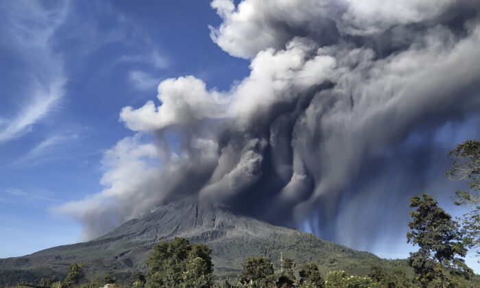 Mount Sinabung spews volcanic materials during an eruption, in Karo, North Sumatra, Indonesia, on Aug. 23, 2020. (AP Photo)