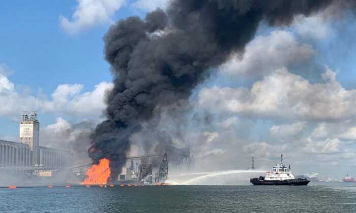 A dredge on fire in the Port of Corpus Christi Ship Channel, in Texas, on Aug. 21, 2020. (Courtesy of U.S. Costal Guard)