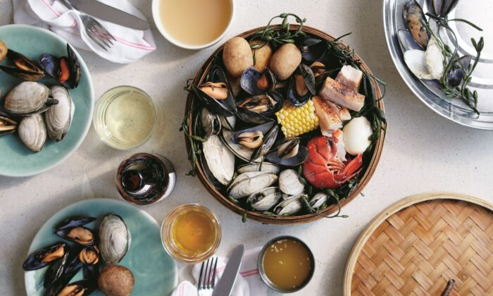 Eventide's smaller-scale, home kitchen-friendly clambake condenses the experience to a bamboo steamer basket set over a wok. (Zack Bowen)