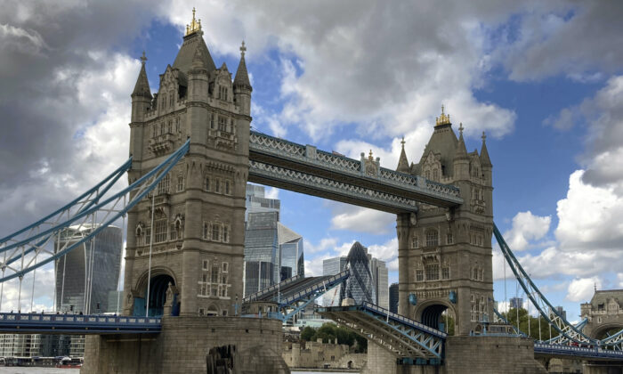 Tower Bridge is stuck open, leaving traffic in chaos, on Aug. 22, 2020. The historic bridge has failed to close Saturday after opening to allow ships to pass underneath on the River Thames. (Tony Hicks/AP Photo)