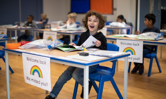 Children sit at individual desks during a lesson at the Harris Academy's Shortland's school in London on June 4, 2020. (Dan Kitwood/Getty Images)