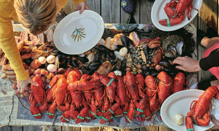 A clambake should be 'casual, familial, and abundant, focusing on the beauty of nature and breaking bread with loved ones,' write the authors of the 'Eventide' cookbook. (Zack Bowen)
