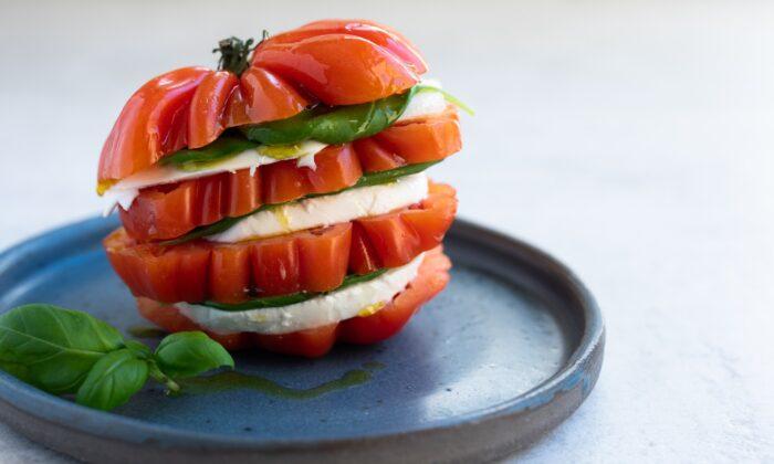 Summer tomatoes meet fresh mozzarella and basil in caprese, a classic Italian salad. (Delphine Remy/Shutterstock)