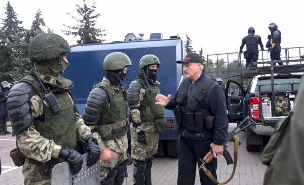 Alexander Lukashenko greets riot police officers