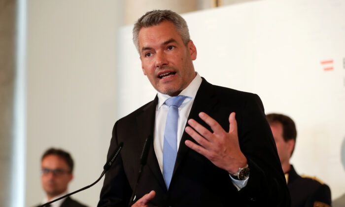 Austrian Interior Minister Karl Nehammer addresses a news conference in Vienna on Aug. 24, 2020. (Leonhard Foeger/Reuters)
