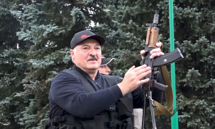 This image made from video shows Belarus President Alexander Lukashenko armed with a Kalashnikov-type rifle near the Palace of Independence in Minsk on Aug. 23, 2020. (State TV and Radio Company of Belarus via AP Photo)