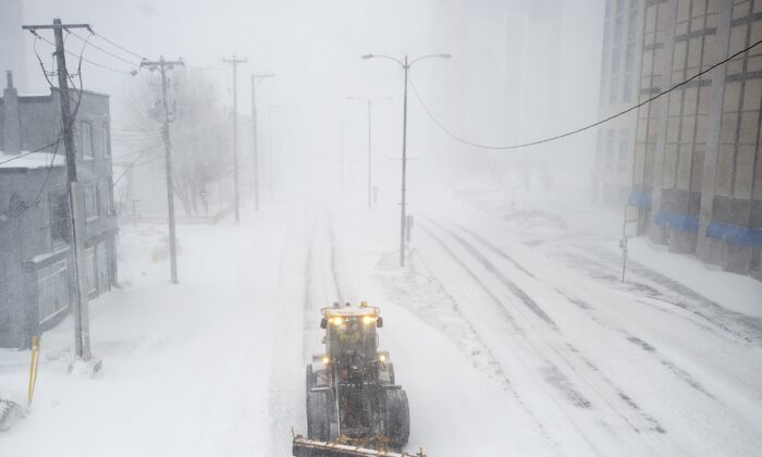 A snowplow clears a path in St. John's during a state of emergency as blizzard conditions descend on the Newfoundland and Labrador capital on Jan. 17, 2020. (Andrew Vaughan/The Canadian Press)
