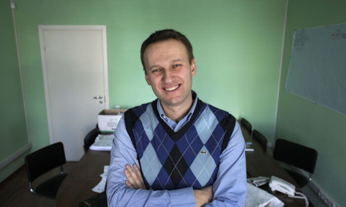 Then corporate lawyer Alexei Navalny poses in his office in Moscow, on March 17, 2010. (Alexander Zemlianichenko/AP Photo)