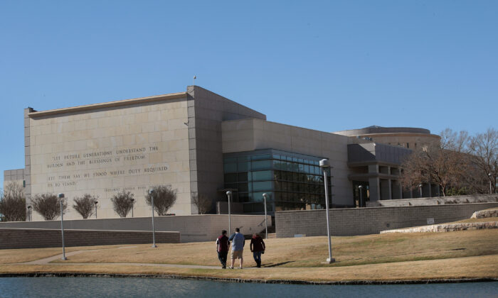 Visitors walk along a pond behind the George H.W. Bush Presidential Library Center on the campus of Texas A&M University in College Station, Texas, on Dec. 2, 2018. (Scott Olson/Getty Images)