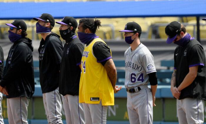 Los Angeles Dodgers players wear Kobe Bryant's Los Angeles Lakers jersey to honor the late superstar prior to a baseball game at Dodger Stadium in Los Angeles, Calif., on Aug. 23, 2020. (Kevork Djansezian/Getty Images)