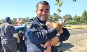 Heartwarming Picture Captures a CHP Officer Holding a 6-Week-Old Baby After a Car Crash