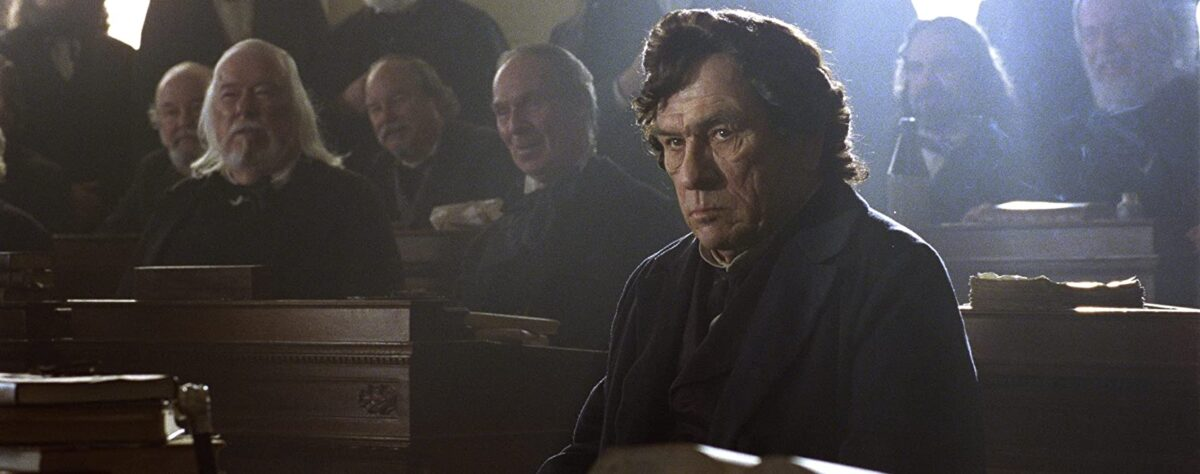 "man in crowded room in ""Lincoln"""