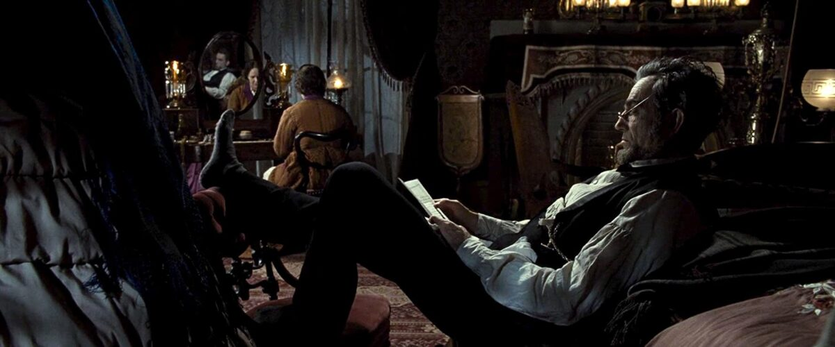 "Man reclining holding papers in ""Lincoln"""