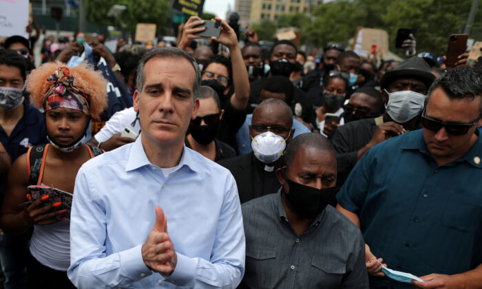 Los Angeles Mayor Eric Garcetti stands next to demonstrators during a protest in Los Angeles, Calif., on June 2, 2020. (Lucy Nicholson/Reuters)