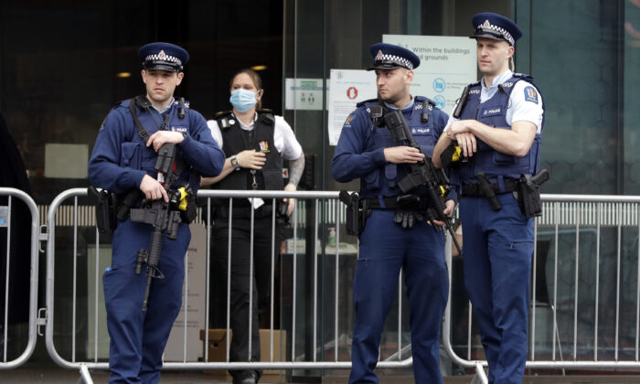 Police stand outside Christchurch High Court as family and survivors from the March 2019 Christchurch mosque shootings arrive for the sentencing of 29-year-old Australian Brenton Harrison Tarrant, in Christchurch, New Zealand on Aug. 24, 2020. (Mark Baker/AP)