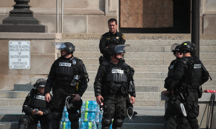 Police gather in front of the Kenosha County Courthouse in Kenosha, Wis., on Aug. 24, 2020. (Scott Olson/Getty Images)