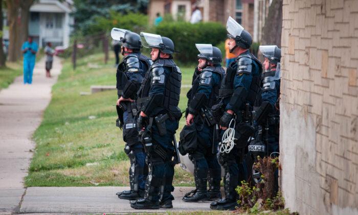 Police in riot gear in Milwaukee, Wisconsin, on Aug. 15, 2016. (Darren Hauck/Getty Images)