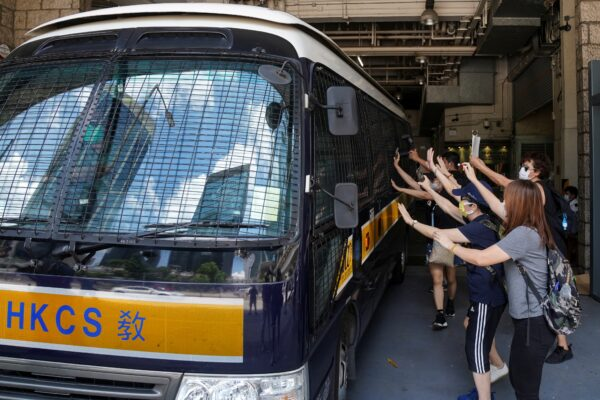 Supporters bid farewell to a prison van