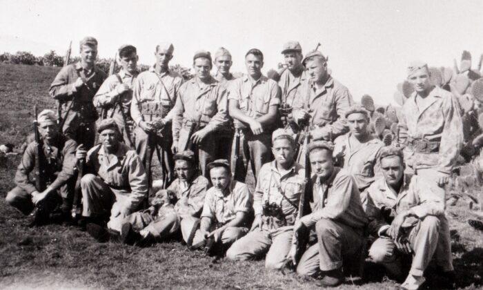 "The ""40 Thieves on Saipan."" The platoon consisted of 40 Marines who served on the island of Saipan in WWII. (Standing L–R) Richard Knoll, Francis Moynihan, Barney Wheeless, Daniel Kenny, Ira Causey, Albert Malanga, Corporal Don Evans, Bill Emerick, Bernie Jones. (Seated L–R) Otto Hebel, Al Yunker, John Zuziak, Lonnie Jackson, Hal Moore, Wayland Stevens, Keith Clark, Sergeant Bill Knuppel. (Joseph Tachovsky Collection)"
