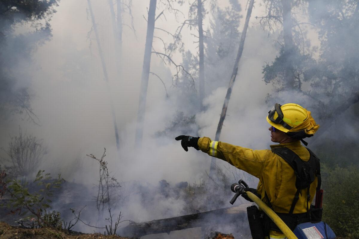 Firefighter monitors hot spots