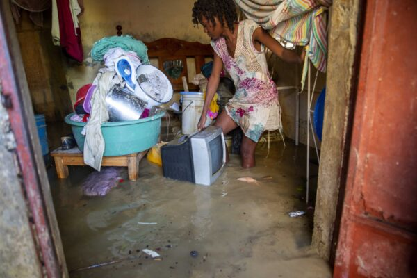 Lafaille Katia removes salvage items from her flooded house