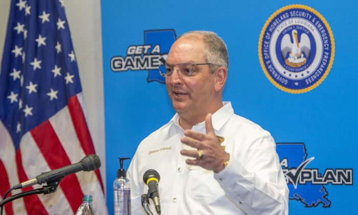 Louisiana Gov. John Bel Edwards answers questions while holding a media briefing about the state's activity related to Hurricanes Marco and Laura in Baton Rouge, La. on August 24, 2020. (Bill Feig./The Advocate via AP)