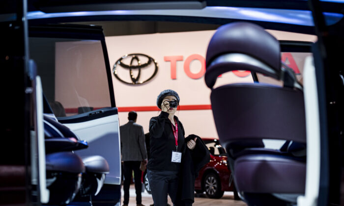 A woman photographs the interior of the Toyota concept car Fine-Comfort Ride at the Canadian International Auto Show in Toronto on Thursday, February 14, 2019. (Christopher Katsarov/The Canadian Press)