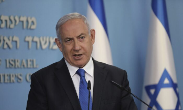 Israeli Prime Minister Benjamin Netanyahu announces that full diplomatic ties will be established with the United Arab Emirates, at a news conference in Jerusalem on Aug. 13, 2020. (Abir Sultan/Pool Photo via AP)