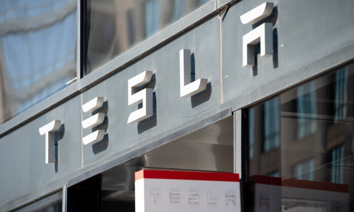 The Tesla logo is seen outside of their showroom in Washington on Aug. 8, 2018. (Saul Loeb/AFP via Getty Images)